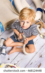 the boy on the floor with nautical decor