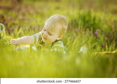 Boy on a green lawn