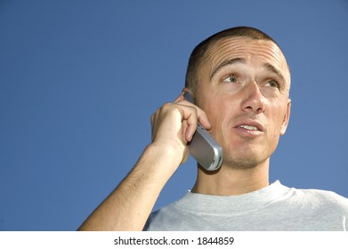 Boy on the phone looking surprised