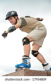 Boy on rollerblades in starting position