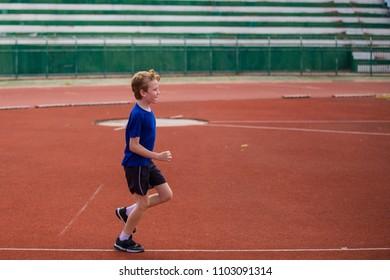 Boy on the running track.