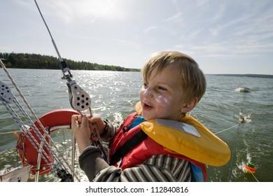 A boy on a sailing-boat, Sweden.