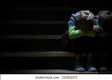 Boy on a stairway at night, horizontal