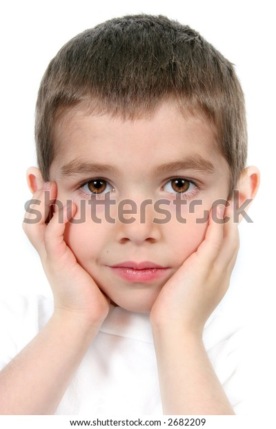 Boy on white background with hands to face - Closeup
