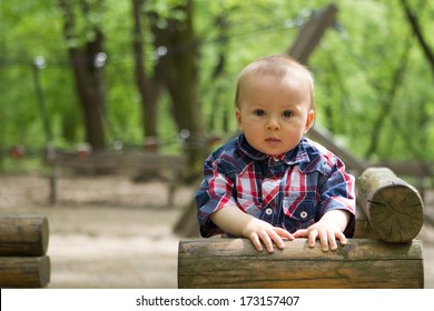 Boy on a wooden train in a park