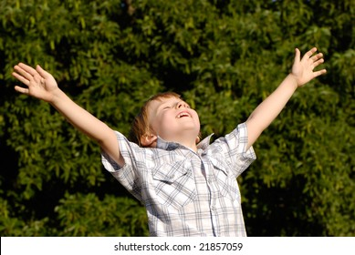 The boy with open hands lifted to sky