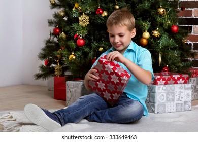 Boy opens Christmas gift