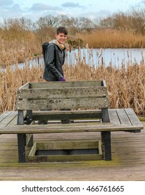 Boy out to explore nature and birdwatching