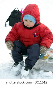 boy outdoors in skates in winter