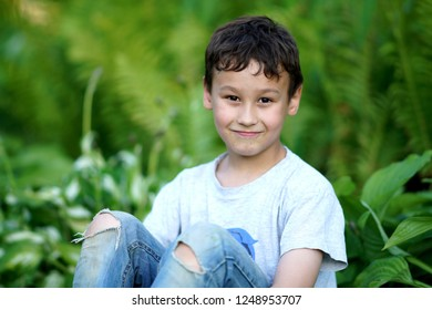 boy outdoors in summer day
