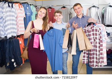 Boy with parents brags new clothes in clothing store