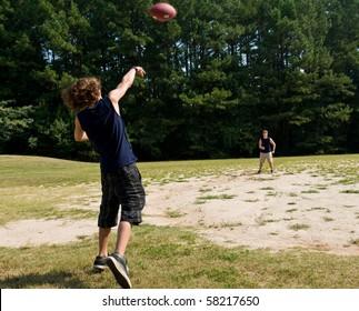 boy passing football
