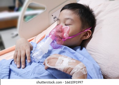 Boy patient with asthma allergy using the asthma inhaler.Inhaler mask for treatment in hospital.Health asthmatic in hospital.healthcare and medical concept