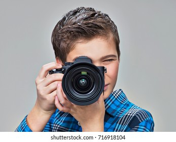 Boy with photo camera taking images. Teenager  boy  with  camera photographing