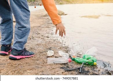 Boy picking up empty of bottle plastic ,volunteer concept