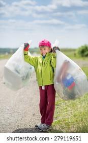 Boy picking up trash