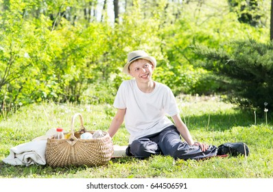 Boy at a picnic in the park