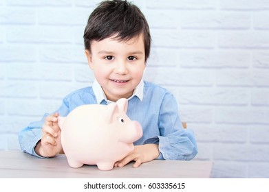 boy with pig piggy bank. childhood, money, investment and happy people concept