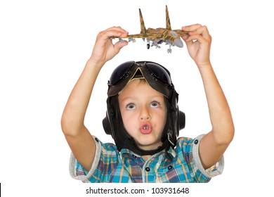 Boy in pilot helmet play with jet fighter model