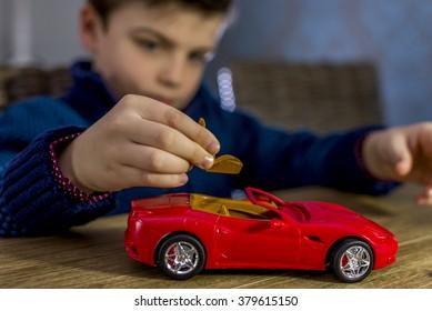 boy placing seat in a model car kit