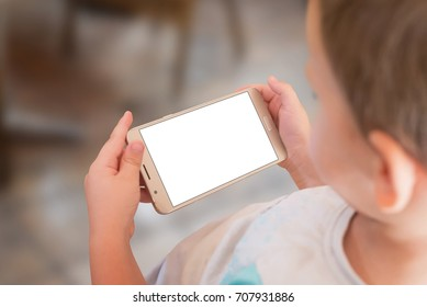 Boy play game on smart phone. Isolated screen of mobile for game app presentation.