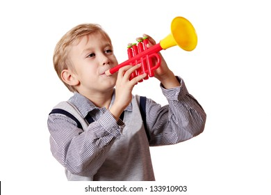boy play trumpet on white