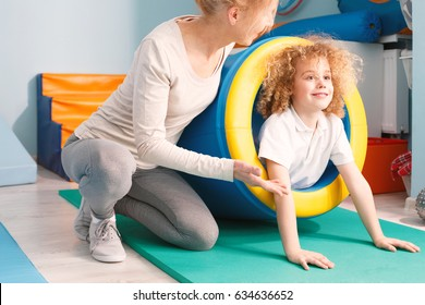 Boy in play tunnel exercising at senory gym
