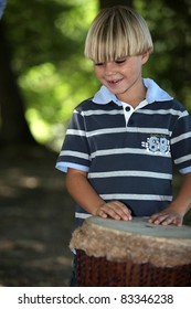 Boy playing African drum