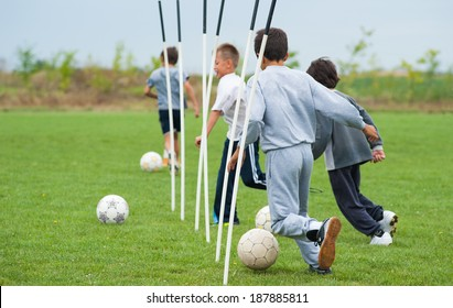 boy playing with a ball on the soccer field