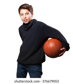 boy playing basket