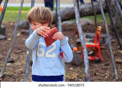 boy playing bean bag toss.