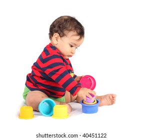 Boy playing with colorful cups