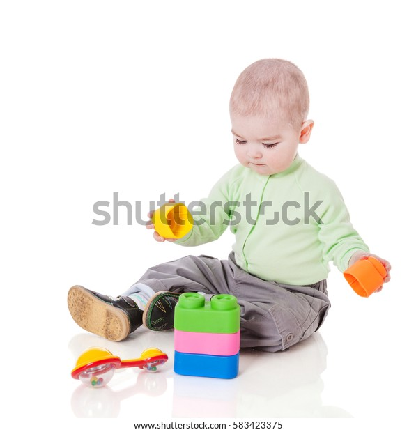 boy playing with colorful toys isolated on white