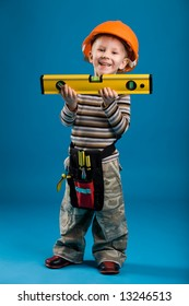A boy playing construction worker, isolated