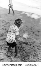 Boy playing cricket on the beach