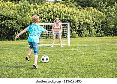boy playing football outdoor on a summer day
