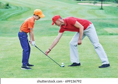 Boy playing golf in summer