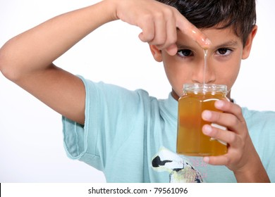 Boy playing with honey