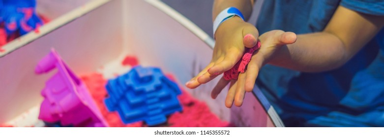 Boy playing with kinetic sand in preschool. The development of fine motor concept. Creativity Game concept BANNER, long format