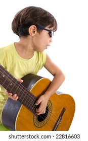 Boy playing a music with his wood guitar