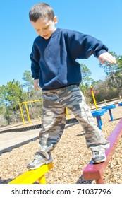 boy playing on balance beams