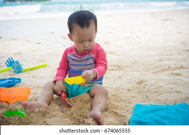 A boy is playing on the beach.