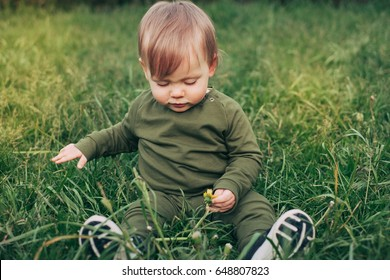 Boy playing on the grass