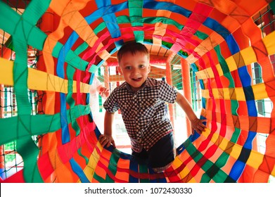 Boy playing on the playground, in the children's maze.