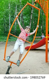 a boy playing on the Playground in the Park