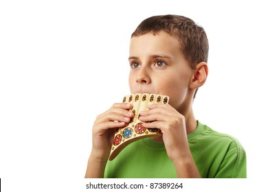 Boy playing the panpipe, isolated on white background