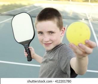Boy playing Pickleball