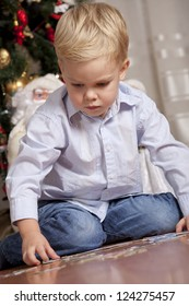 Boy playing with puzzle at christmas