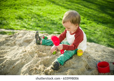 The boy is playing with sand