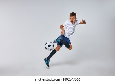 boy playing soccer, happy child, young male teenager enjoying sports game, isolated portrait, kids activities, little soccer player
